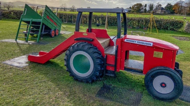 Massey Ferguson playground tractor slide celebrates village farming community and memory of Lakeland machinery